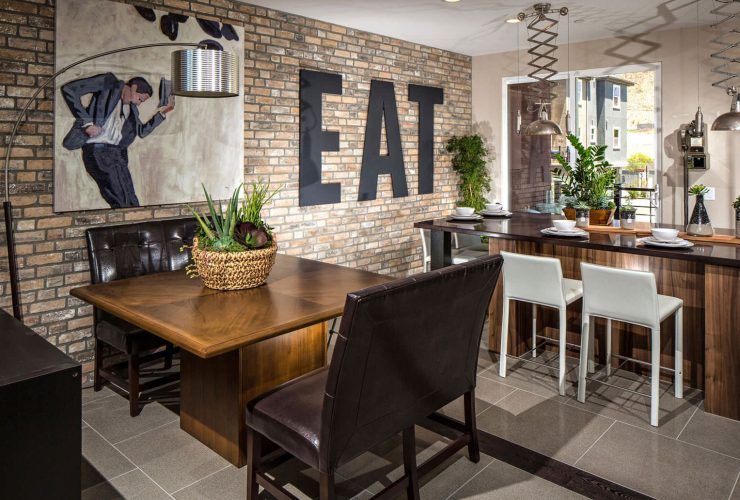 a dining room accent wall made from thin brick tile