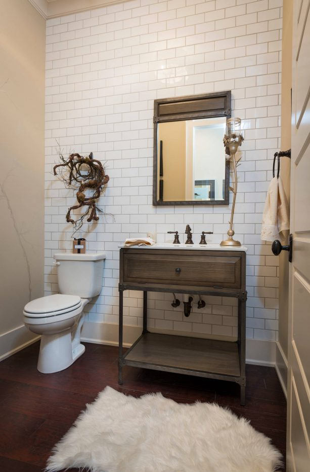 an accent wall from white subway tile and light smoke grout