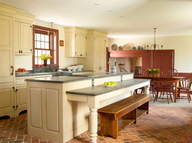 brick tile flooring in herringbone pattern in a farmhouse kitchen