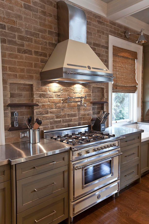 brick tile to add texture on the wall and backsplash of a farmhouse kitchen