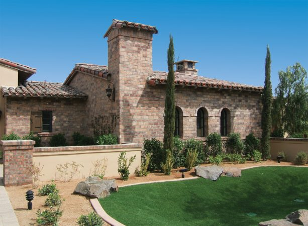 brick tile to remodel a house exterior to have the look of authentic stone brick