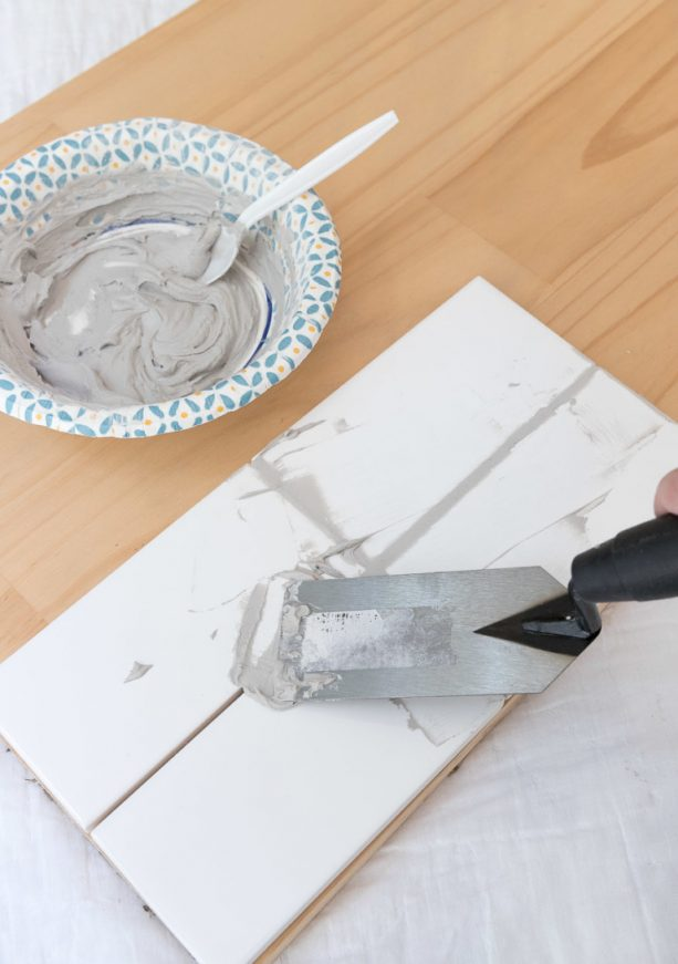 creating sample to see the gray grout look on white subway tile