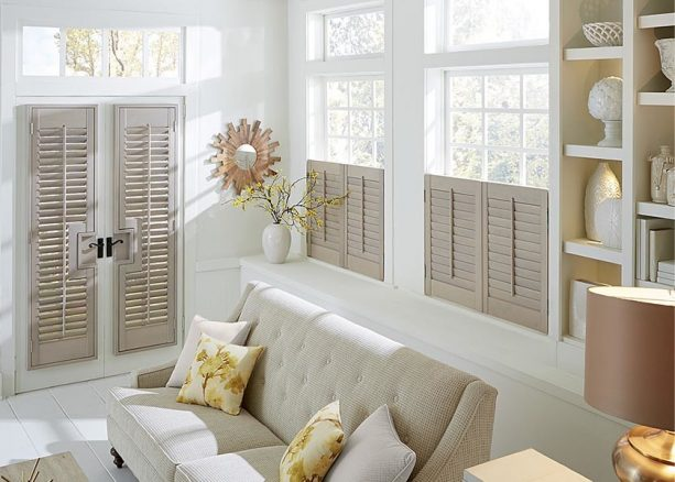 grey Graber plantation shutters covering white French doors