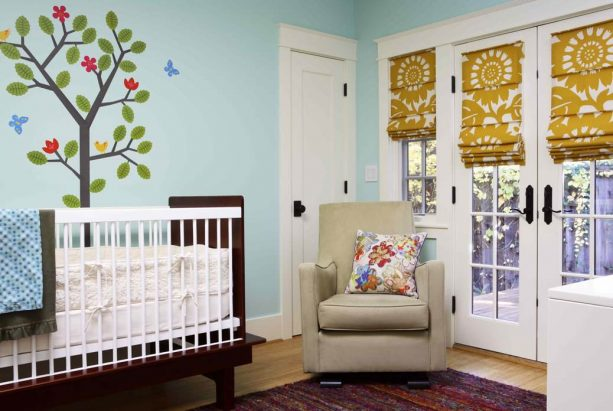 large-patterned slat front blackout roman shade for nursery French doors