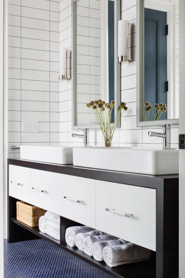 perfect vertical white subway tile wall with charcoal gray grout