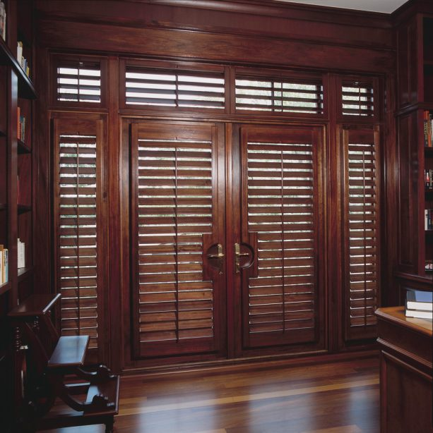 plantation shutters in custom stain to cover brown French doors