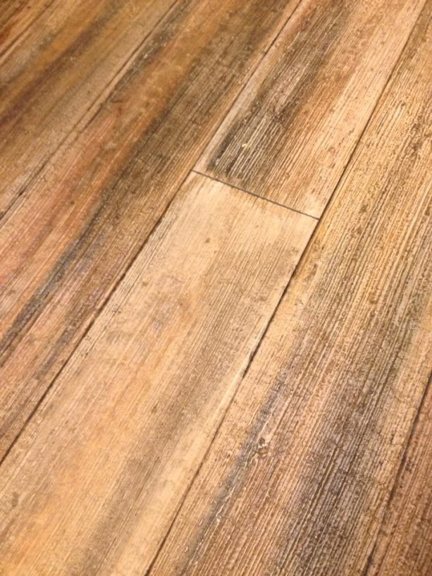 the result of light broom method on faux wood planks from concrete