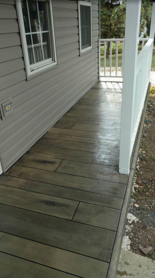 the use of medium tone concrete wood floor in porch area