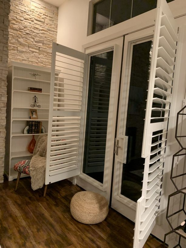 white plantation shutter that open