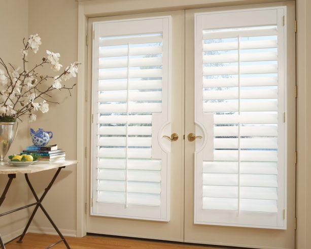 white vinyl plantation shutters on a warm white French doors