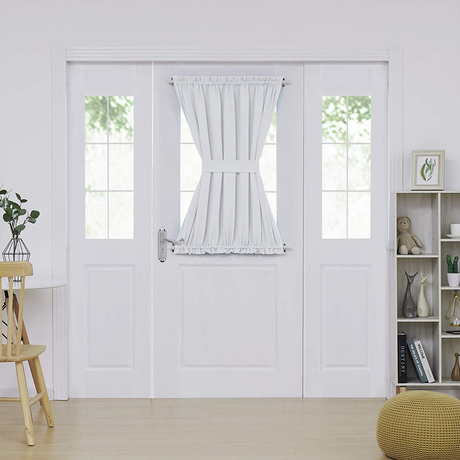 a white French door panel curtain with tieback for adding privacy in a half glass door design