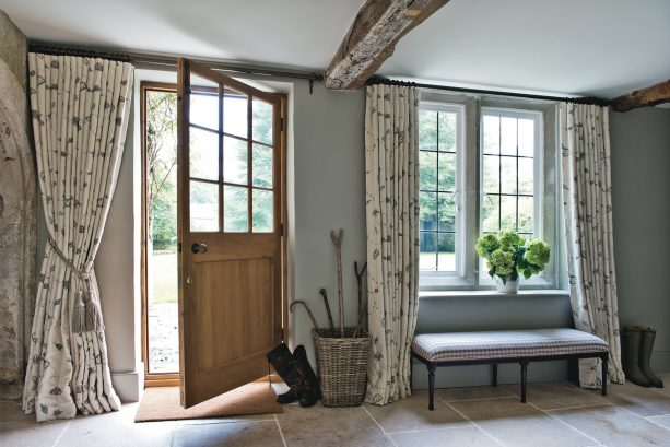 beige floral floor-length curtain with tassel tier