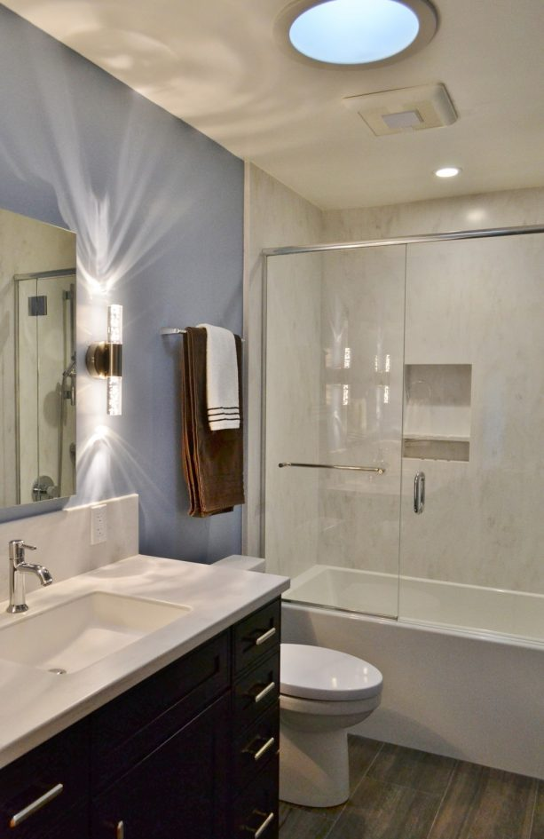 off white solid surface shower walls in a transitional bathroom
