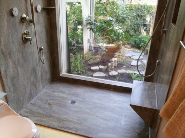 solid surface covering not only the shower walls but also floor