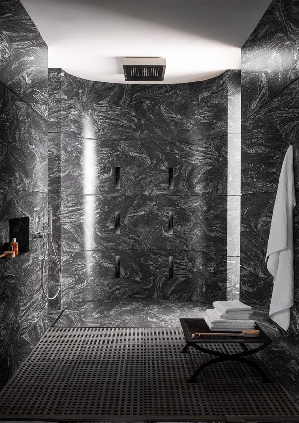 stunning Cosmos Prima black solid wall panels in a contemporary shower
