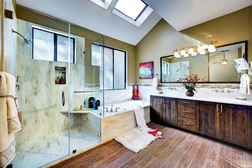 warm tone solid surface on the walls of a transitional shower