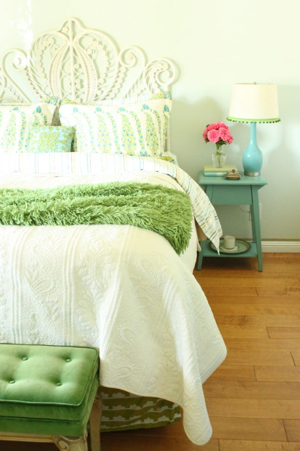 a rustic bedroom with turquoise and green theme