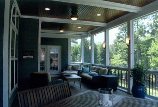 a screened beach-style porch with tongue and groove ceiling and exposed beams