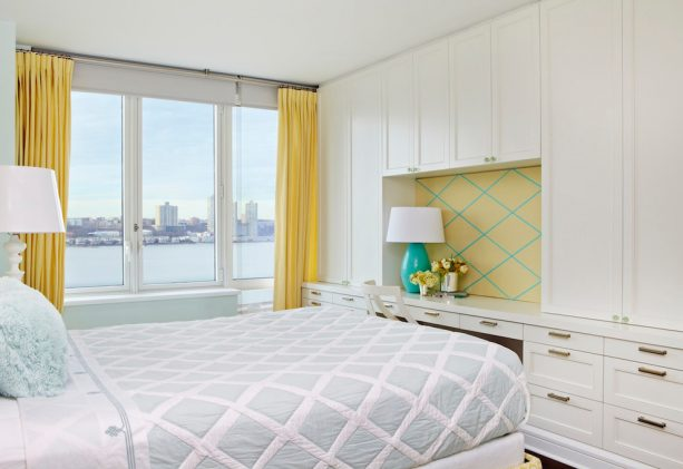 a transitional bedroom with turquoise and mustard yellow decorations