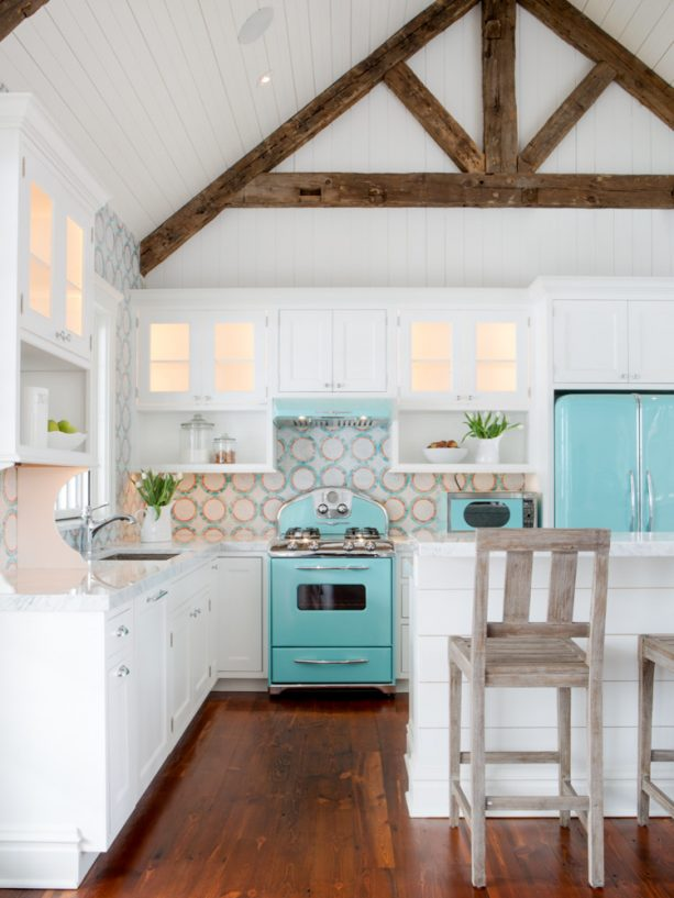 beach-style kitchen with turquoise appliances and white furniture