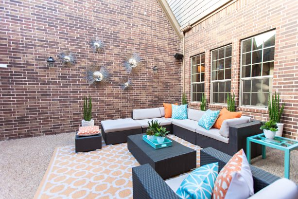 turquoise and tangerine pillows on patio furniture set