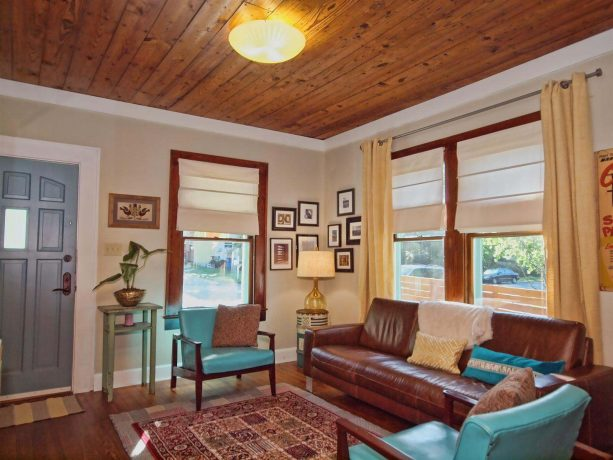 turquoise leather chairs with wooden frame in a traditional living room