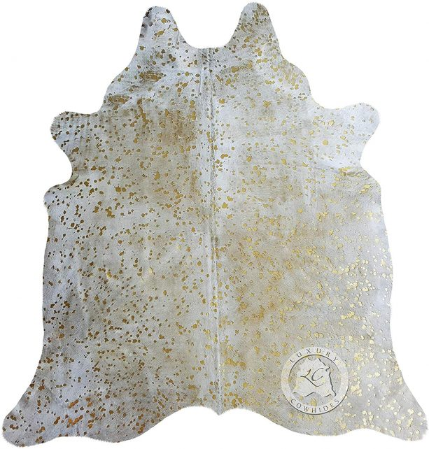 Sunshine Cowhides off-white rug with metallic gold details