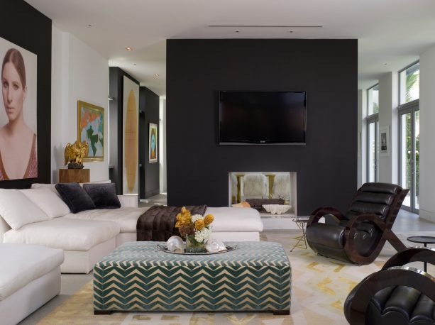 black and white contemporary living room with white and gold rug