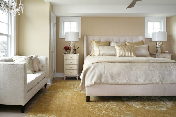gold area rug with white flowers patterns in a neutral transitional bedroom