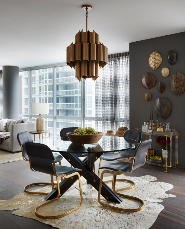 white and gold cowhide area rug in a black dining room