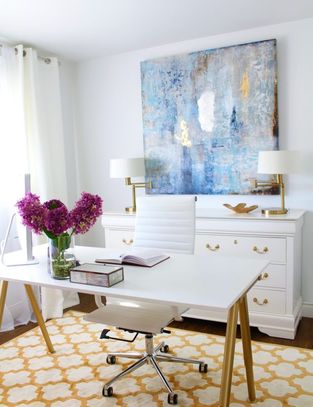 white home office with white and gold rug