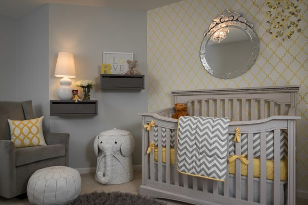 gray and yellow themed nursery wall decor with floating shelves