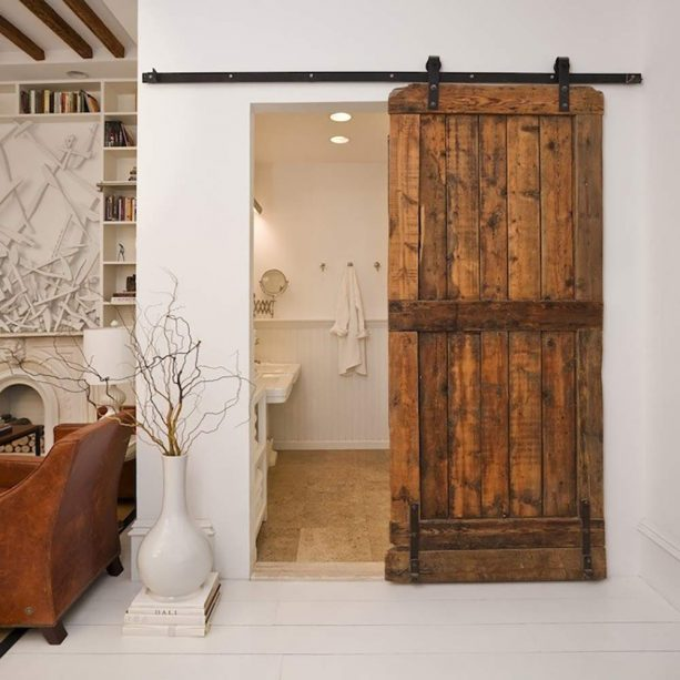 a public bathroom barn door in an eclectic living room