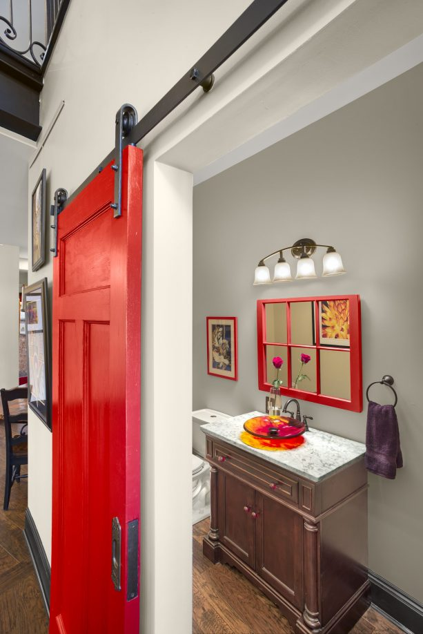 bright red contemporary barn bathroom door with black track and hardware