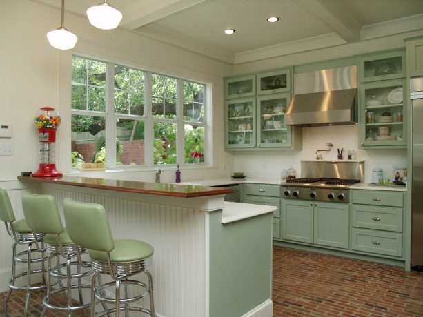 a half wall that also works as a breakfast bar in a traditional open kitchen