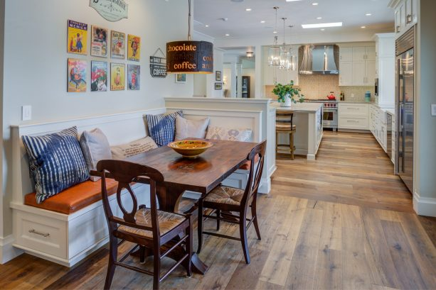 a small half wall dividing the open space between a kitchen and a farmhouse dining room