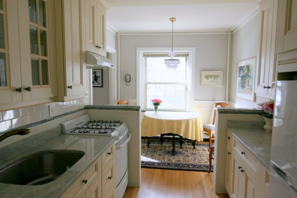 half walls on two sides of a traditional kitchen