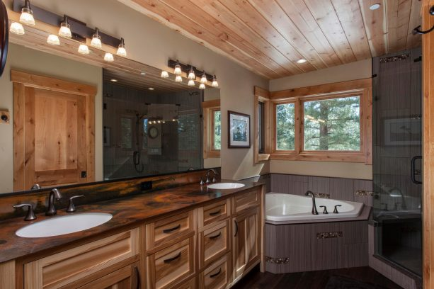 hickory cabinets and dark wood floor in a contemporary mountain style bathroom