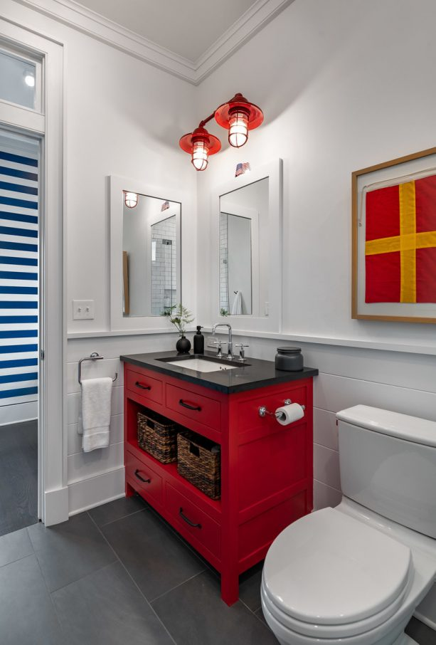 a red and black themed bathroom vanity with single-sink