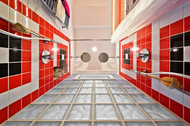 a red, black, and white shower room seen from below