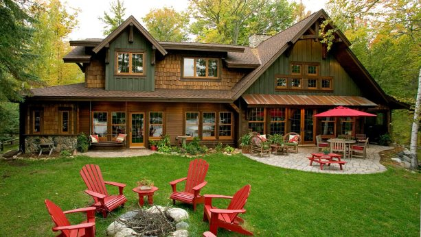 a rustic wood house with brown roof