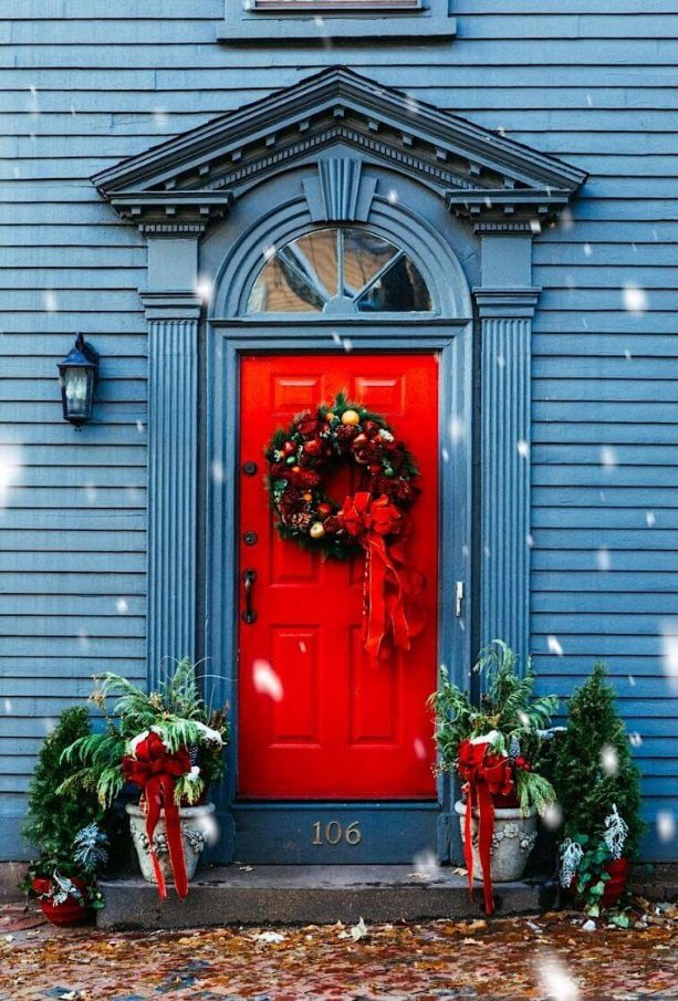 a stone blue house with candy red door