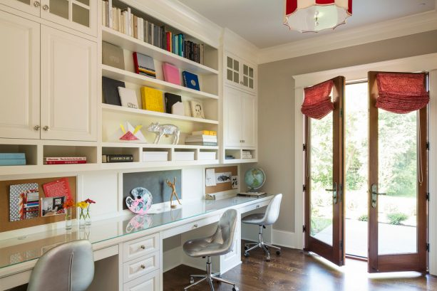 a traditional home office with glass-wood doors and white trim
