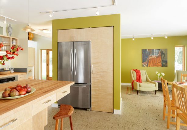 cabinets and refrigerator hidden inside the wall