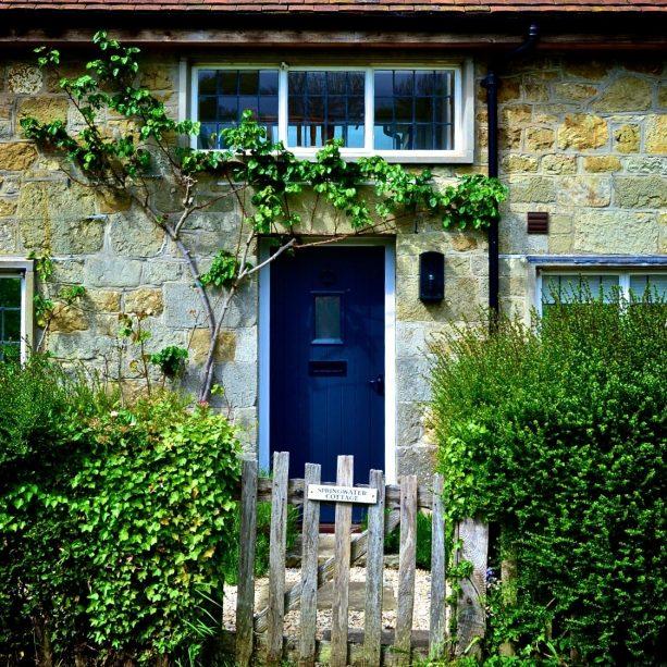 rustic front door with navy blue color