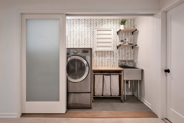 a stylish laundry room with glass pocket doors