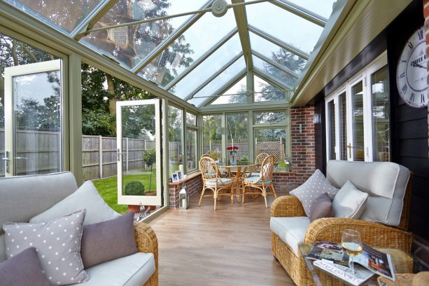 a sun room addition with an elegant sage green color
