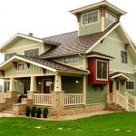 red accents in a sage green home exterior design