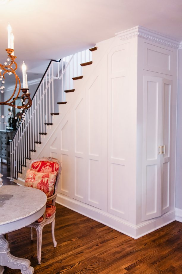 the laundry closet is hidden excellently under the stair