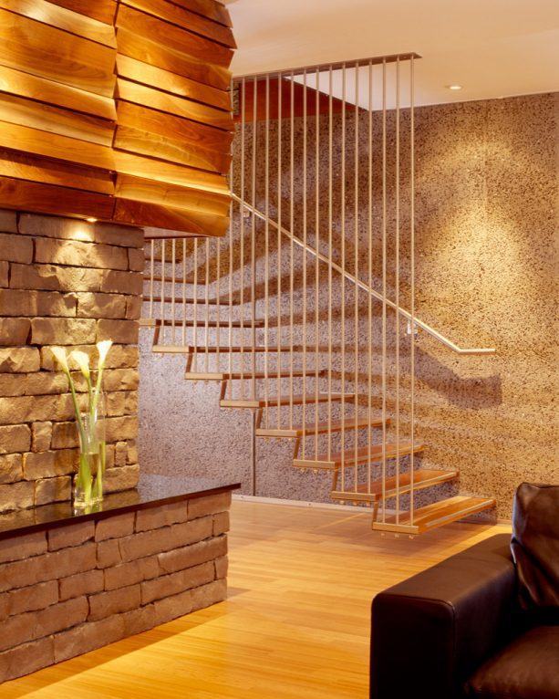 a modern basement floating staircase with open-style and ceiling-height guard